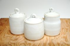 White pottery jars,clay containers,white lidded vessels,spice jars,storage jars,ceramic jar set,white home decor,clay kitchen containers by Emburr on Etsy https://www.etsy.com/listing/240668592/white-pottery-jarsclay-containerswhite