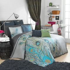 This beautiful duvet cover set features a bold and sophisticated fashion statement with climbing peacock feathers that embellish the duvet cover and shams. Vibrant hues of blue, yellow and orange complement the neutral and grey bedding. Peacock Bedding, Peacock Bedroom, Peacock Decor, Peacock Design, Feather Bedding, Peacock Colors, Dream Bedroom, Home Bedroom, Bedroom Decor