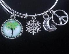 This is a bright, cheap and cheerful bracelet with elements of peace and nature shining through.