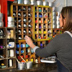 In the studio of encaustic artist Rebecca Stahr. Wall of encaustic wax paints. #encausticartist #artstudio #abstractart www.rebeccastahr.com