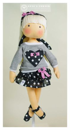 Susie is a sweet rag doll for small children with removable clothes (blouse, skirt, panties and headband). All clothes are removable and easy to take