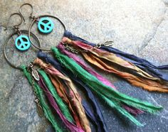 a pair of hippie gypsy hoop earrings with sari silks and peace signs. READY TO SHIP Ribbon Jewelry, Jewelry Crafts, Beaded Jewelry, Jewlery, Tassel Jewelry, Skull Jewelry, Tribal Jewelry, Diamond Jewelry, Silver Jewelry