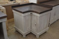 Corner unit with doors. With a 40 mm Ash Top, dark stain.