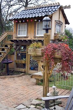 An Asian inspired tiny house built over a chicken coop.  this would make a nice studio or potting shed..