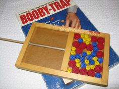 So many toys I've forgotten... this game was super fun! The bar was spring-loaded and you had to pull out the pegs