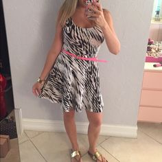 sundress Cute and comfy sundress in abstract animal print. Exposed Zipper back gives detail. Fit and flare style is flattering on all figures. Must have  for spring/summer! Belt is NOT included Express Dresses