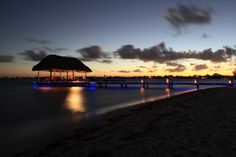 Sunset over Placencia, Belize. Chabil Mar Resort at dusk, a beautiful #Belize #photosofBelize #Belizeresorts #dininginBelize #seasidedining #travel #CentralAmericaresorts