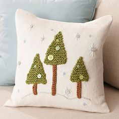 This picturesque scene is crafted using simple knitting, crocheting, and embroidery techniques. The winter wonderland pillow is great for Christmas decor and can be displayed all winter long.