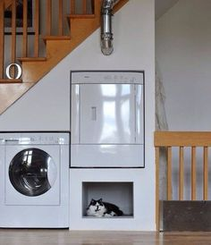 Install a washer and dryer under the stairs! From Bob Villa. Maybe one could put a washer/dryer combo in a tiny house lift staircase.