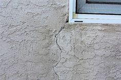To repair stucco, you can use any number of commercially sold products. Using a cold chisel and hammer, widen the crack to at least a quarter inch. The edges of the crack should be chiseled perpendicular to the wall. Use caulk gun to apply stucco repair compound along the crack.