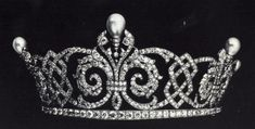 A diamond and pearl tiara with celtic designs and fleur-de-lys. This tiara belonged to Queen Alexandra of Great Britain.