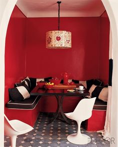 Brick Red makes a big, bold statement in this cool dining nook.