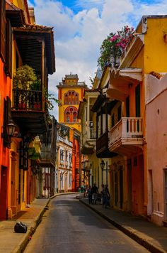 Cartagena de Indias Colombia Colorful narrow street with flowers and quaint balconies. Hello!