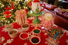 Hot Chocolate Bar - mix-ins: crushed malted milk balls, peanut butter cups, heath bar, mini-m&m's.  Whip cream, marshmallows, dipped candy canes for stir stick.