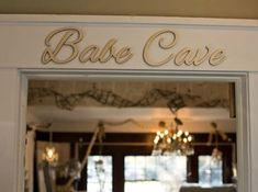 Babe Cave cursive letters. Font: Alex Brush. Vanity Room, Girl Cave, Woman Cave, Lady Cave, College House, College Apartments, Lounge, Babe Cave Sign, Villa