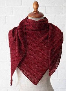 This is a triangle (slightly asymmetrical) shawl , knit sideways.
