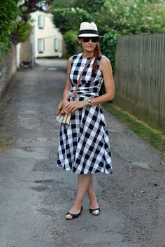 I love that she styled this nearly midi-length gingham dress with pointed toe flats!! It really works!