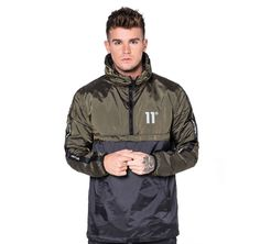 11 degrees khaki green and black rain jacket