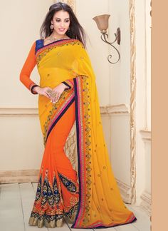 This brilliant array will make you the ultimate classic beauty at the next event you attend. Create a smoldering impact by this yellow and orange georgette designer saree. This ravishing attire is ama...