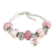 Give any outfit an eye-catching upgrade with this lovely charm bracelet. Featuring pink and white glass beads and a silverplated snake style chain, this bracelet is a charming, elegant addition to you
