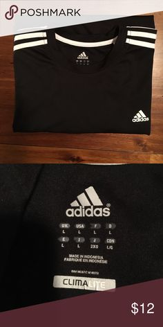 Adidas shirt Short sleeve. Armpit to armpit is 21 1/2 inches. Length from shoulder to end is 28 inches adidas Shirts