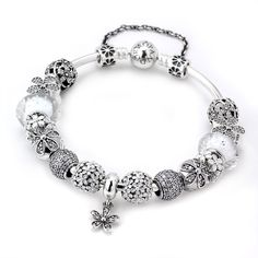 PANDORA Upsy Daisy Charm Bracelet -  Time for sundresses and sunglasses!  The PANDORA Upsy Daisy Charm Bracelet is just the way to show off your summer dazzle!This charm bracelet includes a mix of elegant clear murano glass and CZ charms balanced with enamel daisy charms. An excellent way to start the summer!