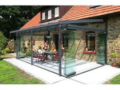 Verranda with open glass walls. Their mox wood/alu version looks better Outdoor Decor, Patio Room, Seating Area, Stone Houses, Cottage Extension, Old Home Renovation, Yard Design, Sunroom Designs, Outdoor Seating Areas