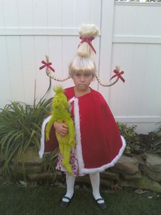 Cindy Lou Who from the Grinch.... I made the hair and my sister made the cape (which covered the broken arm underneath!!)