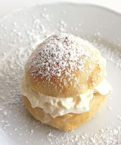 cardamomlove:    oohhhbaby:  cardamom buns with whipped cream   It's called semla or fettisdagsbulle in swedish, and it's delicious!