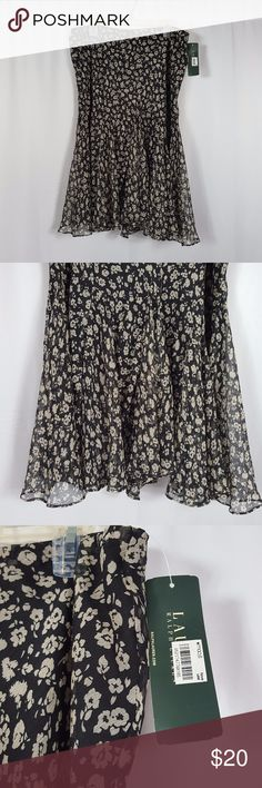 """Lauren Ralph Lauren Floral Skirt Black and Beige Very nice polyester skirt with polyester lining. Has a flared hem at the bottom with extra panels for volume. Gently used with no stains or flaws. Elastic waistband.  Waist: 18""""  across Hips: 27"""" across Length: 30""""  If you have any questions, please ask. Thanks for looking and have a blessed day! Lauren Ralph Lauren Skirts A-Line or Full"""