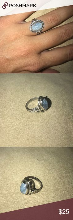 """Vintage Blue """"Sterling"""" Silver Ring Vintage ring, probably from the 1930s. Blue starburst stone. Size 6. Delicate design. Interior marked """"Sterling"""" Leaf designs on the side of the ring. ✨Bundle for savings✨ Jewelry Rings"""