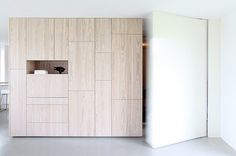 :: DETAILS :: designed by Boetzkes Helder. Adore the oversized flush pivot doors, lovely detail along side white washed wood cabinetry, what looks like ash? love #details