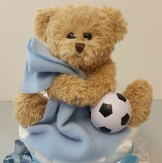 A little theme for your Baptism decorations for boys or girls - Add a soccer ball to our Blankie Bear Baptism balloon centerpieces for boys or girls for a wonderful soccer baby shower detail! http://www.settocelebrate.com/ctbc10-tt.html