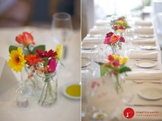 simple blooms in simple jars decorate tables at this relaxed beach wedding
