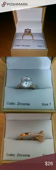 SALE Cubic Zirconia Ring Size 7, brand new, never worn, purchased 2017 January from Macy's. Looks like a real diamond and not sure if one or 2 karrot. In flawless excellent condition.  Beautiful and elegant trim of zirconia on both sides that lead to the large diamond in the center.   Smoke free home and pet free.  W/all my listings comes a free gift from my home state of Hawai'i! Charter Club Jewelry Rings