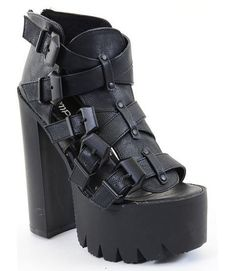 Take your edgy style to a higher level in these massive, sexy platforms! Featuring crinkled leatherette upper, open toe, chunky platform with lug sole, strappy design with adjustable buckles, rear zip