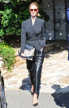 Rosie Huntington-Whiteley in a belted jacket, leather trousers, and black pumps