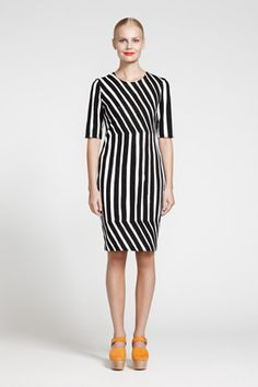 This dress is a combination of straight, vertical and diagonal lines. The diagonal lines create a feeling of excitement and movement