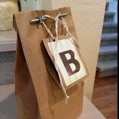 Man -wedding shower gift wrapping!!!  Brown paper bag, with screw & bolt closure.