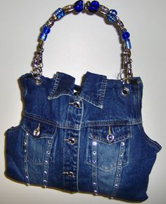 how to make a denim bag Archives - The Best Jeans, Accessories, and Premium DenimDenim vest into purse with pretty beaded handlesCheryl Brooks Denim Handbags BB: just pic. Cheryl Brooks is an up and coming designer and I think some of her denim bags Denim Handbags, Cute Handbags, How To Make Handbags, Blue Jean Purses, Diy Sac, Denim Purse, Denim Crafts, Old Jeans, Denim Jeans