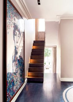Wooden stairs and oversized artwork
