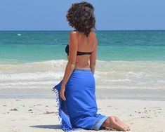 Simone-et-Georges-Kikoy-Stranddoek-Bora-Bora  Dit Kikoy strandlaken met badstof voering weegt slechts ca. 500 gram en neemt weinig ruimte in je koffer en strandtas, neemt gemakkelijk vocht op en is na gebruik snel weer droog.