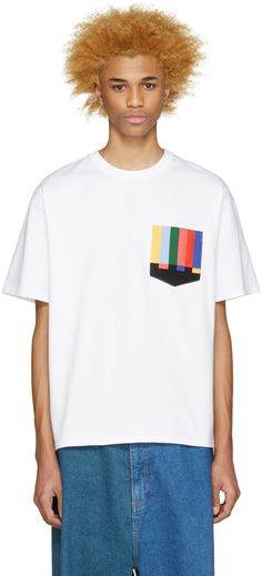 Short sleeve t-shirt in white. Crewneck collar. Multicolor striping at breast pocket. Tonal stitching.