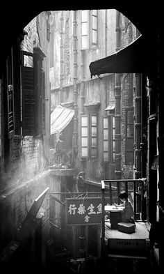 Street life: A girl studying in old Hong Kong (1950) | Fan Ho - B&W Photography (Texture)