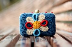 Clutch  crocheted  in navy blue and embroidered in funny by lanusa
