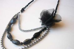 Upcycle old beaded jewelry into a pretty tiered necklace with this tutorial