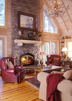 The fireplace is actually a wood burning furnace. When the power went out in an ice storm, the cabin stayed warm. www.modernrustichomes.com
