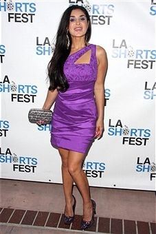 Actress Saye Yabandeh at the Los Angeles Film Festival with the Tal clutch.