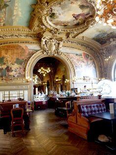 """Le Train Bleu Restaurant (The Blue Train), located in the hall of the Gare de Lyon railway station in Paris. It was granted historical monument status in 1972. Some of the restaurant's """"regulars"""" have been the likes of Coco Chanel, Brigitte Bardot, and Salvador Dali. It was built for the Universal Exhibition of 1900."""