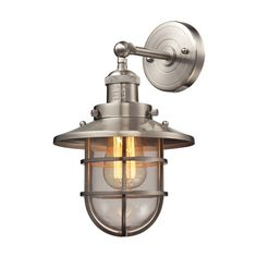 Add a nautical look to any room's décor with this Elk Lighting Seaport Wall-Mount Sconce. The vintage style light features a solid crosshatch patterned steel cage encircling a clear glass, adding an oceanic theme to your décor. Elk Lighting, Wall Lights, Clear Glass, Brass Lighting, Steel Cage, Brass Wall Sconce, Wall Sconce Lighting, Titan Lighting, Wall Mounted Sconce